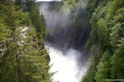 Rushing water and water vapor below Cleveland Dam.jpg